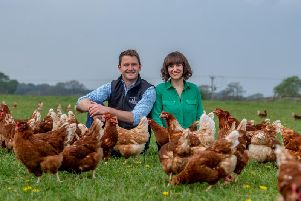 Ben and Emma with some of their 6,000 hens