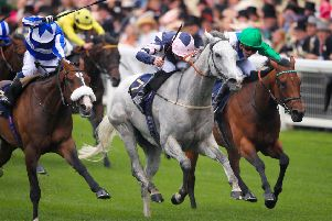 The grey Lord Glitters bursts clear to win the Queen Anne Stakes at Royal Ascot for trainer David O'Meara and jockey Danny Tudhope.