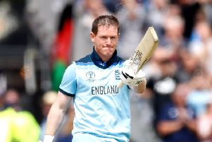 England's Eoin Morgan raises his bat after reaching a century at Old Trafford. Picture: Martin Rickett/PA