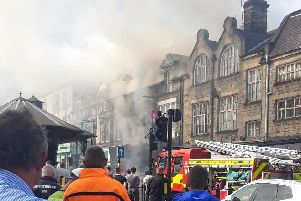 A cordon is in place while crews battle the fire. Picture: Carol Walsh.
