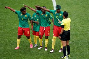 Cameroon's Augustine Ejangue (left to right), Gabrielle Aboudi Onguene (second left), Ajara Nchout (centre) and Gaelle Enganamouit (second right) appeal to match referee Qin Liang (right) after England's second goal was given by VAR after an offside call.