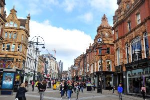 Shoppers on Briggate in Leeds. UK's retail environment is the most challenging since 1991, according to Colliers International.