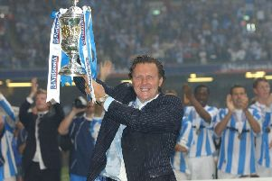 Job done: Huddersfield Town manager Peter Jackson celebrates promotion after beating Mansfield Town in a penalty shootout in the Nationwide Division Three play-off final in Cardiff in 2004.
