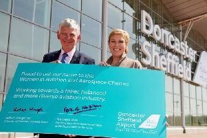 Robert Hough, chair of Peel Group & DSA, and Baroness Vere with their signed pledge to encourage more women to work in aviation