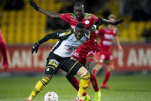 Lokeren's Bambo Diaby and Essevee's Ibrahima Seck fight for the ball during a soccer match between Sporting Lokeren and SV Zulte Waregem in January. Picture: JASPER JACOBS/Getty Images.