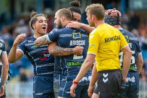 Featherstone Rovers players celebrate Luke Briscoe's try against Leigh Centurions. Picture: James Heaton