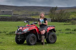 Amanda Owen on one of the family's quad bikes. The stolen vehicle is a green Yamaha Grizzly 700