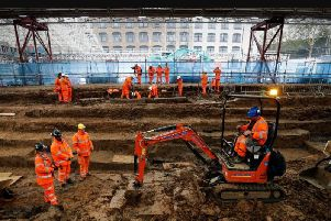 Field archaelogists excavate a late 18th to mid 19th century cemetery under St James Gardens near Euston train station in London on November 1, 2018 as part of the HS2 high-speed rail project.