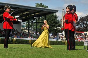 Soprano Lizzie Jones performs at the 161st Great Yorkshire Show in Harrogate with the band from the Yorkshire Regiment. Picture Tony Johnson.