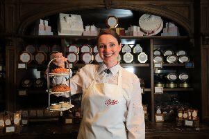 Bettys Craft Bakery, Harrogate. Following the life of a Fat Rascal from the bakery to Bettys Cafe Tea Rooms in Harrogate. Pictured is staff member Joanne Smith with a tray of Fat Rascal at the Cafe Tea Rooms. Picture: Chris Etchells