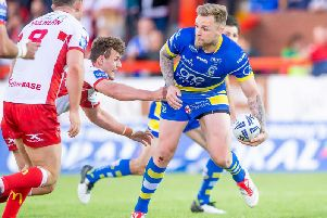 Warrington's Blake Austin offloads as he's tackled by Hull KR's George Lawler. (PIC: Allan McKenzie/SWpix.com)