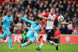 AFC Bournemouth's Lys Mousset (centre) has a shot on goal against south coast rivals Southampton. Picture: Adam Davy/PA