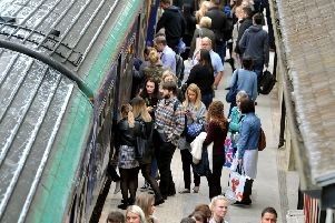 Commuters trying to board a trian at Horsforth during last year's rail chaos.