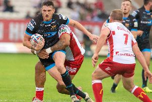 Huddersfield Giants' Lee Gaskell takes on Hull KR's Adam Quinlan (PIC: BRUCE ROLLINSON)