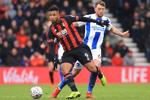 Bournemouth's Lys Mousset (left) and Brighton & Hove Albion's Dale Stephens battle for the ball during the Emirates FA Cup, third round match at the Vitality Stadium, Bournemouth. (Picture; PA)