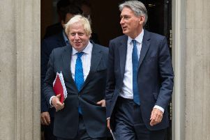 Chancellor Philip Hammond (right) will resign on Wednesday if, as expected, Boris Johnson, the former Foreign Secretary, becomes Prime Minister this week.