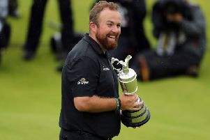 TOP OF THE WORLD: Shane Lowry celebrates winning the Claret Jug at The Open at Royal Portrush. Picture: Niall Carson/PA