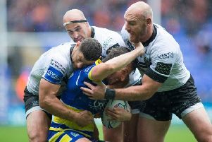 NOT THIS TIME: Stefan Ratchford of Warrington is tackled by Mark Minichiello, Danny Houghton and Gareth Ellis of Hull. Picture: Isabel Pearce/SWpix.com