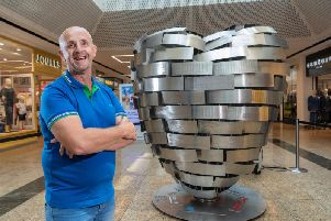 Barnsley father Tony Surgey, a retired police officer, is among those backing the British Heart Foundation's 'Heart of Steel'. The 52-year-old, diagnosed with a heart tumour, engraved his father in law's name on the steel sculpture.