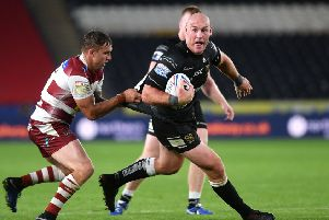 YP columnist Gareth Ellis is tackled by Wigan's Sam Powell.' (Picture: Jonathan Gawthorpe)