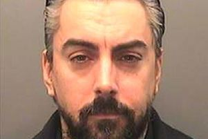 Ian Watkins is accused of having a mobile phone in his cell at Wakefield Prison
