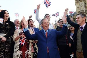 Nigel Farage and his supporters celebrate in London in June 2016 the night after Britain's vote to leave the European Union. Picture: Anthony Devlin/PA Wire
