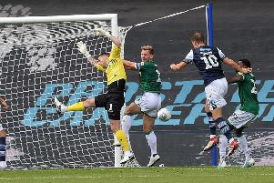 Owls keeper Keiren Westwood misses a cross only for Millwall's Matt Smith to head in the winner. Picture: Steve Ellis