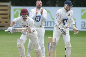 Heading to the title: Brad Schmulian, of leaders Woodlands, top-scored with 54 as they defeated Pudsey St Lawrence. Picture: Steve Riding