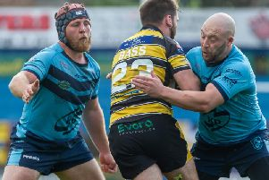 Luke Cooper and John Davies aim to stop Jason Bass in Featherstone Rovers' game at York. Picture: James Heaton