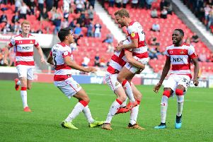 Doncaster Rovers' James Coppinger and team-mates celebrate their winning goal against Fleetwood (Picture: Marie Caley).