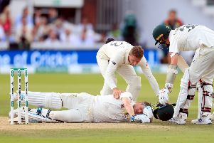 England's Jos Buttler shows concern for Australia's Steve Smith after the batsman slumped to the ground having been hit on the head by a delivery from Jofra Archer (Picture: Mike Egerton/PA Wire).