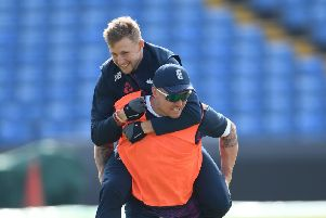 RIDE YOUR LUCK: Yorkshire's England Test captain Joe Root takes a piggy back from opening batsman Jason Roy, who faces a further concussion assessment at Headingley this morning. Picture: Stu Forster/Getty Images.