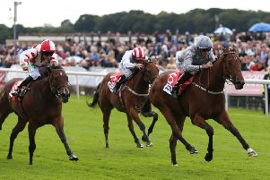 LEADING LIGHT: Living In The Past and Daniel Tudhope (right)  win The Sky Bet Lowther Stakes at York. Picture: Nigel French/PA