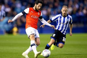 Sheffield Wednesday's Barry Bannan (right) and Luton Town's Jacob Butterfield battle for the ball.