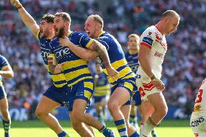 Warrington's Daryl Clark celebrates scoring a try during the Coral Challenge Cup Final against St Helens at Wembley Stadium (Picture: Paul Harding/PA Wire)