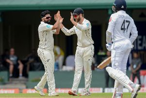 New Zealand's Ajaz Patel, left, is congratulated by captain Kane Williamson after dismissing Sri Lanka's Dilruwan Perera during last month's Test match in Colombo. Picture: LAKRUWAN WANNIARACHCHI/AFP/Getty Images)