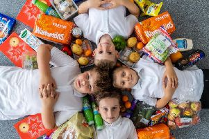 Parklands' pupils Charile Bingham, Isaac Sant, Riley Bingham, and Nevaeh Roberts receive the school's The Real Junk Food Project delivery.