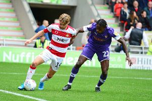 Doncaster's Alfie May and Rotherham's Matthew Olosunde battle for the ball at the Keepmoat. Picture: Marie Cale