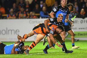 Castleford's Matt Cook is tackled by Hull's Danny Houghton during the Black and Whites' costly defeat.
