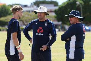 England assistant coach Paul Farbrace talks with captain Joe Root, left, and head coach Trevor Bayliss during net practice in Bridgetown earlier this year. Picture: Shaun Botterill/Getty Images