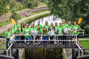 Asda House staff clean up the Leeds and Liverpool Canal.