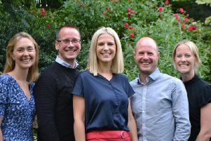 The team from Supported Recruitment, including Helen Russell, centre, and Richard Robinson, to her right, and James Robinson, to her left.