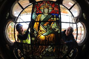 Conservators Alison Gilchrist and Keith Barley place the window into place at the church..11th September 2019. Picture by Simon Hulme