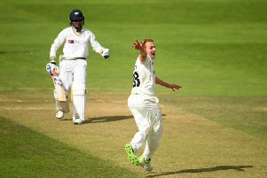GOT HIM: Somerset's Josh Davey celebrates the wicket of Keshav Maharaj on day three at Taunton. Picture: Harry Trump/Getty Images.