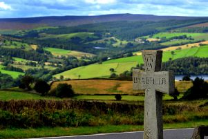 TRANQUIL: Low Bradfield, with its neighbour looking down upon it, is a popular spot for day trippers. PIC: Gary Longbottom