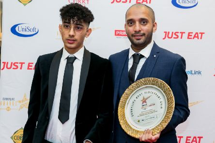 Winners: Oasis Restaurant's Adam Iqbal and owner Imran Ahmed with the coveted award.