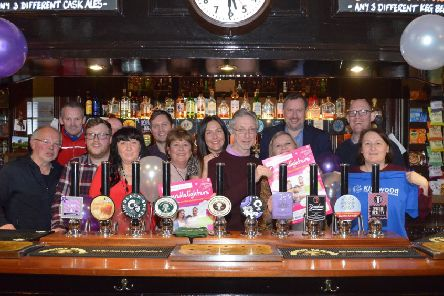 Landmark year: Staff and patrons at Beerhouses get together for a special picture to mark 25 years.