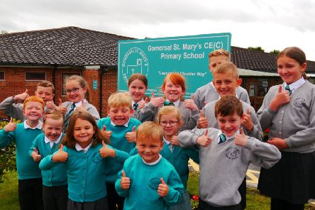 St Mary's Primary School pupils give the thumbs-up to the Ofsted report.