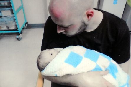 Paul Swaine with his baby son, Jacob just after he was born.