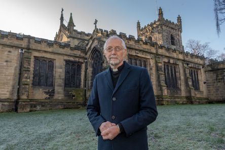 Rev Paul Knight outside St Peter's Church in Birstall.